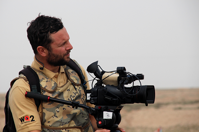 Nick Norman-Butler filming a documentary in Iraq.