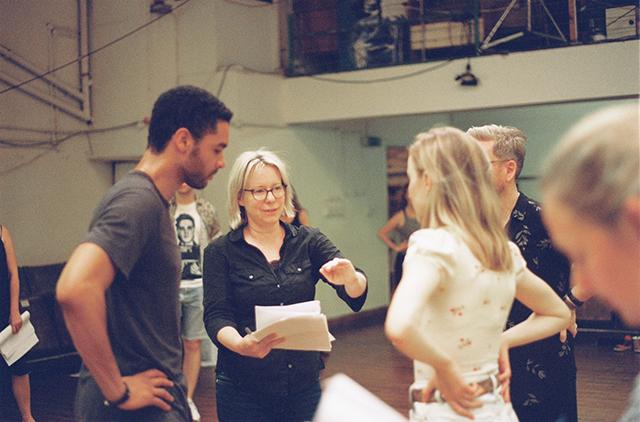 Julie Anne Robinson rehearsing a ballroom scene.